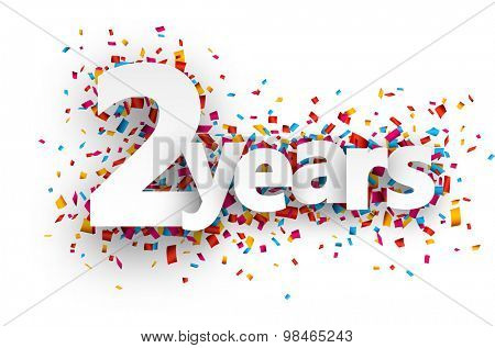 Two years paper sign over confetti. Vector holiday illustration.