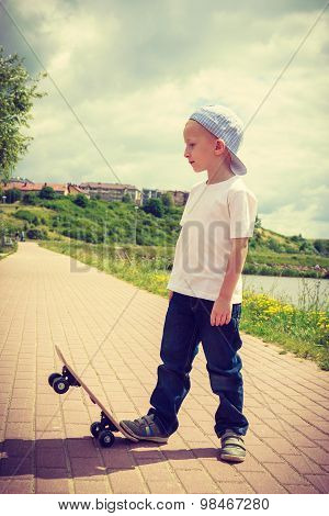 Sporty Child Kid With His Skateboard Outdoor.