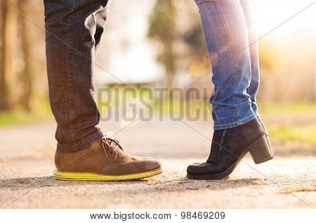 Closeup of woman standing on tiptoe with man