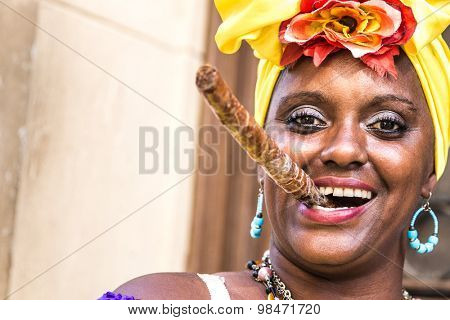 Portrait of african cuban woman smoking cigar and smiling