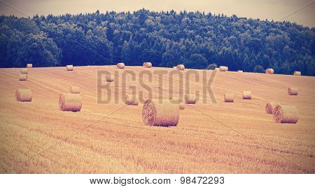 Vintage Toned Hay Bales On Field, Shallow Depth Of Field.