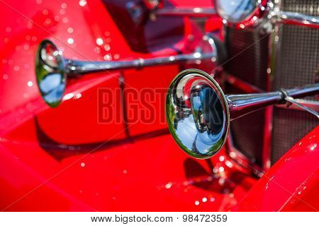 Old horns at an antique vintage red car