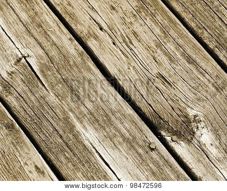 Weathered and worn planks of wood with nails embedded