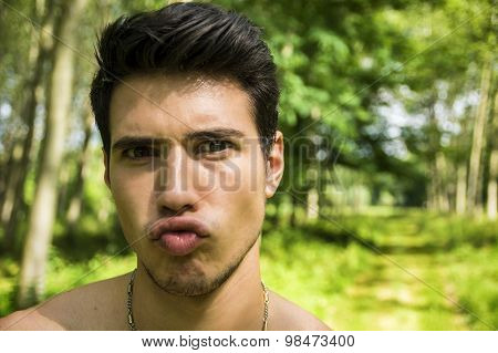 Handsome young man outdoor doing silly face