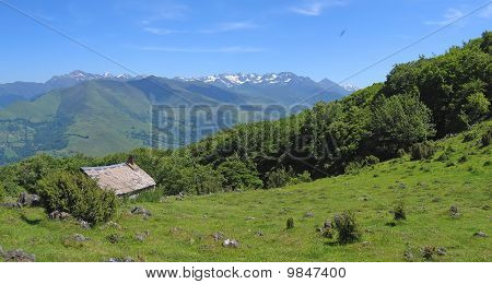 View On The Mountains From The Bibeste Peak With A French Chalet On The Fields, France, The Pyrenees