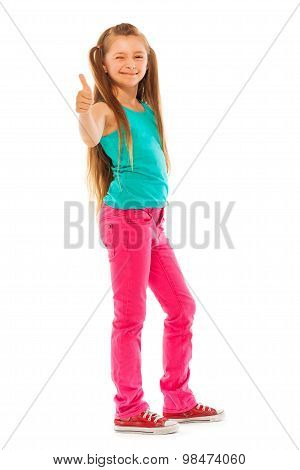 Happy girl stand with thumb up gesture
