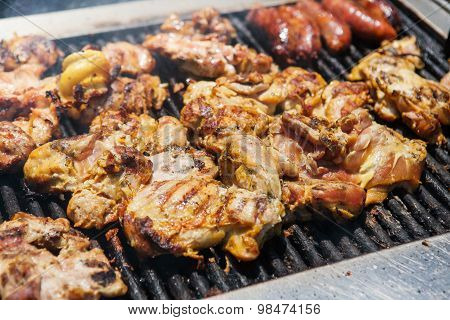 Chicken and sausages on grill selling in the local market. Street american food