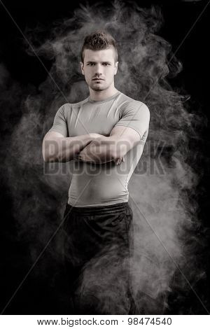 Portrait of handsome tough young man on dark background
