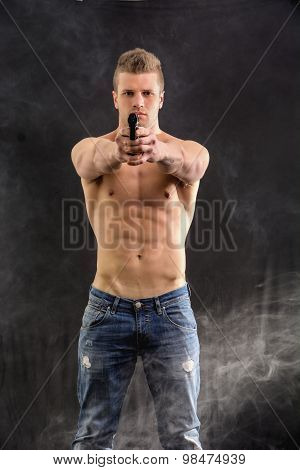 Athletic Topless Man Holding Handgun
