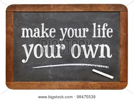 Make your life your own - motivational text on a vintage slate blackboard