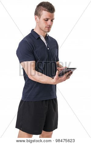Handsome young personal trainer with tablet PC
