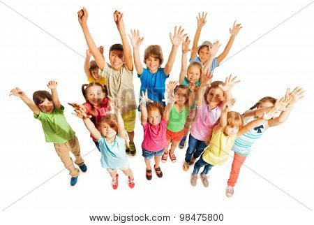 Many kids stand isolated on white in large group