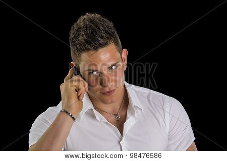 Handsome young man talking on mobile phone