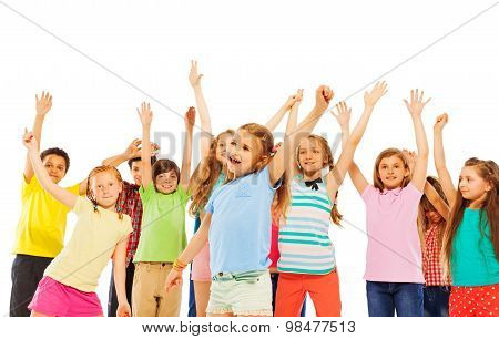 Happy smiling kids rise hands and cheer