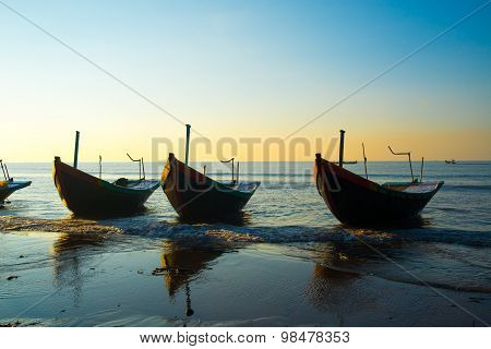 A row of boats on beach