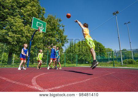 Boy performs foul shot at basketball game