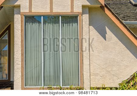 Fragment of the house with nice window.