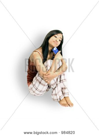 Girl Sitting With A Credit Card