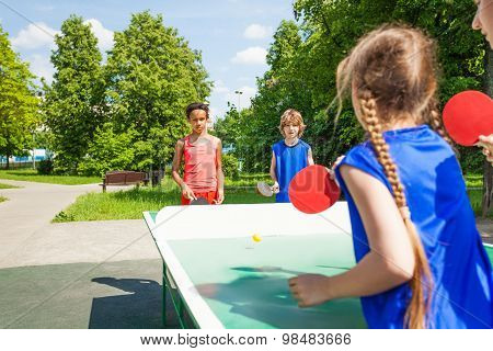 Four international friends play table tennis