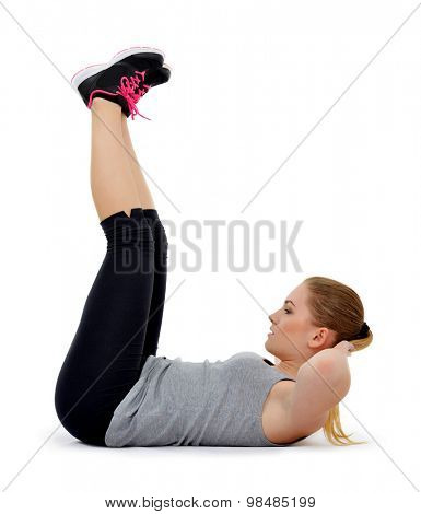 Girl exercising workout fitness aerobic exercise abdominal  on studio isolated