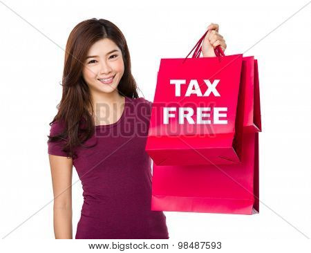 Happy shopping woman raise up the bags showing tax free