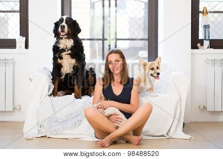 Young woman with three dogs
