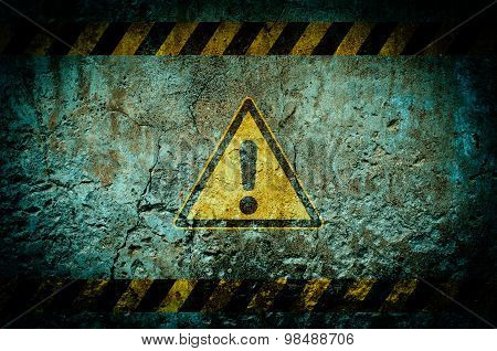 Warning Symbol On Dirty Wall Background With Grunge And Vignette Tone