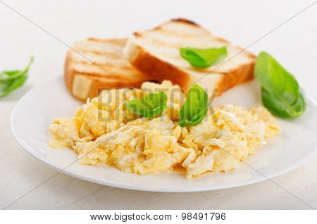 Healthy Breakfast With Scrambled Eggs And Toasts.