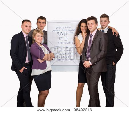 Group of business people looking at the graph on flipchart