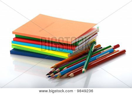 stack of the books and twelve crayons