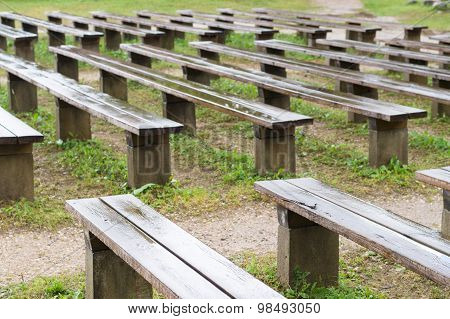 Wet Wooden Benches After Rain In Park, Outdoor Stage Area
