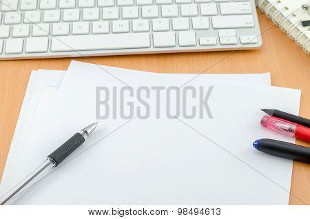 Blank Paper With Pen And Pancil On Computer Desk