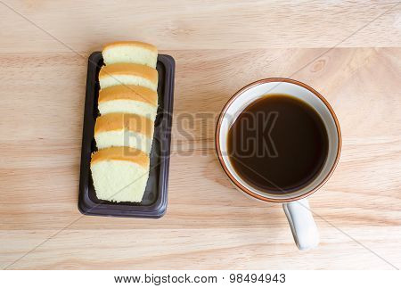 Coffee And Slice Of Butter Cake On Wooden Table