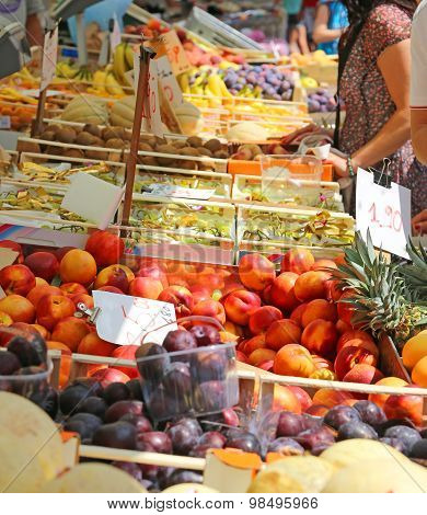 Fruit And Vegetable Stand With Basket Full Of Seasonal Fruits In The Local Market