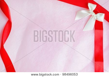 Rosy Pink Paper Texture Background With Ribbon And Bow