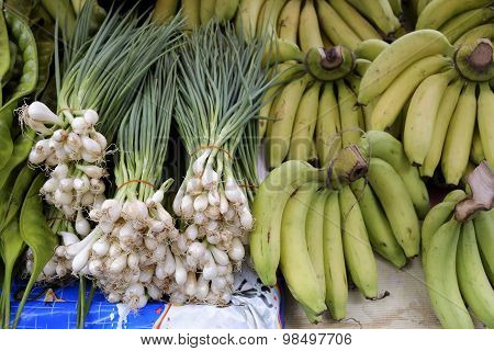 Freshly Harvested Spring Onions And Bunch Banana Ready To Sell At Market