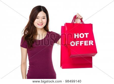 Woman show with shopping bag and showing hot offer