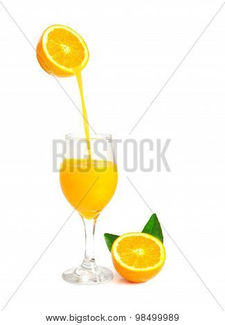 orange juice pouring into glass with orange slice and leaf, isolate on white with work path