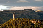stock photo of braveheart  - scotland wallace monument in the landscape mountains - JPG