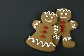 stock photo of gingerbread man  - gingerbread man and gingerbread woman with space for text - JPG