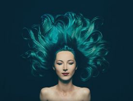 pic of undine  - Portrait of smiling beautiful girl with closed eyes and long hair of turquoise color top view - JPG