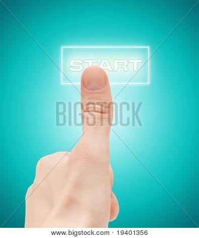 "Man finger push ""start"" button"