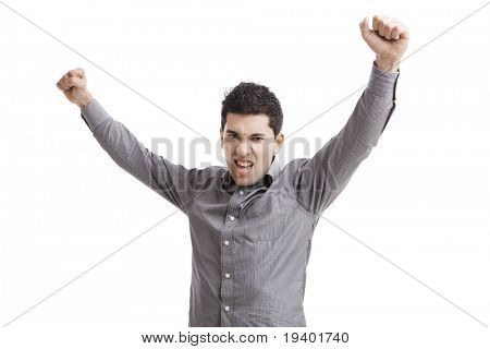 Happy young man with arms up isolated on a white background