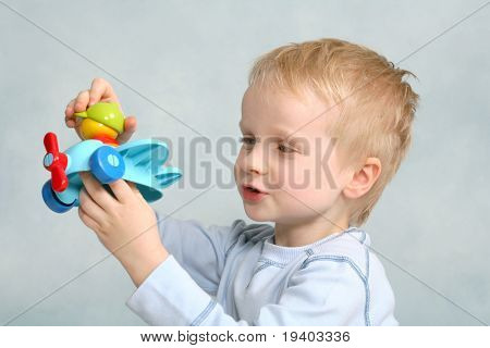 Boy playing with the plane