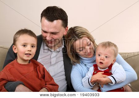 Family with children. One of boys has Down Syndrome