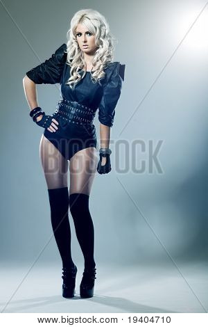 Young blonde in attractive high fashion black clothes with stockings