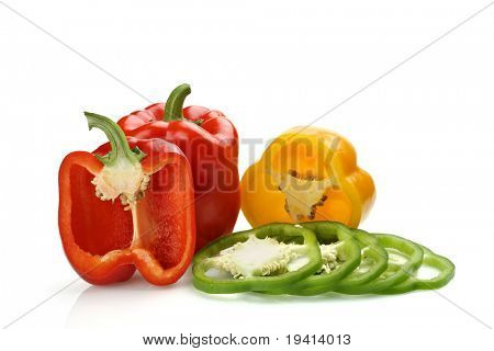 Half and whole red pepper with sliced green and yellow pieces