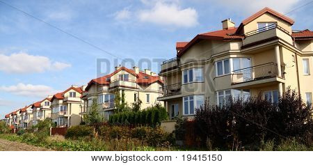 Row of similar houses in suburbia of Warsaw, Poland