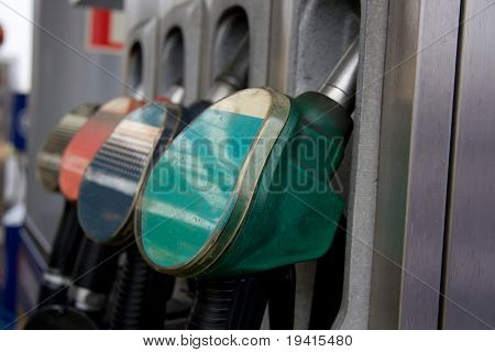 Colorful gas pump nozzles on gas station
