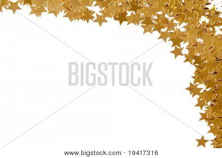 Christmas decoration of golden confetti stars against white background with copy space